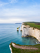 Aerial view at sunrise of the Old Harry Rocks, chalky formations near  Handfast Point, on the Isle of Purbeck in Dorset, Jurassic Coast, southern England.