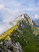 Aerial view of Cima di Bares, Passo Olone and Valzurio valley at the foothills of Pizzo della Presolana. Castione della Presolana, Bergamo province, upper Val Seriana, Lombardy, Italy.
