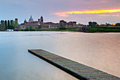 View of the medieval city of Mantua at sunset with Castello di San Giorgio, Palazzo Ducale and the dome of the Basilica of Sant'Andrea. Mantua, Lombardy, northern Italy, southern europe.