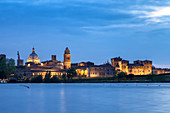 View of the medieval city of Mantua in the evening with Castello di San Giorgio, Palazzo Ducale and the dome of the Basilica of Sant'Andrea. Mantua, Lombardy, northern Italy, southern europe.