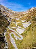 Aerial view of the Tremola San Gottardo road, the longest road monument in Switzerland listed in the inventory of the historic Swiss roads. Passo del San Gottardo, Airolo, Leventina district, Canton Ticino, Switzerland.