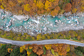 Aerial view of the river Verzasca during foliage time in autumn, near the town of Lavertezzo. Valle Verzasca, Canton Ticino, Switzerland.