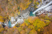 Aerial view of the waterfall of the river Valegg da Cansgell in autumn, near the town of Lavertezzo. Valle Verzasca, Canton Ticino, Switzerland.