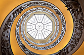 View of the Bramante Staircase, spiral stairs of the Vatican Museums and its skylight from below. Rome, Rome district, Lazio, Europe, Italy.