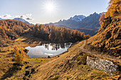 Autumnal sunset in front of the view from Lago Superiore del Sangiatto. Alpe Devero, Antigorio valley, Piedmont, Italy.