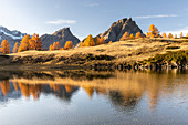 Autumnal view at sunset of the mountains surrounding Alpe Devero from the Laghi del Sangiatto. Antigorio valley, Piedmont, Italy.