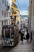 A typical cable car on the streets of Lisbon traveling to Bairro Alto. Lisbon, Portugal, Europe.