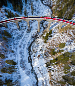 Aerial view of the famous Bernina Express passing over the Landwasser Viaduct. Filisur, Canton of Grisons, Switzerland, Europe.