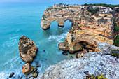 View of the famous natural arches in Praia da Marinha, Caramujeira, Lagoa, Algarve, Portugal, Europe.