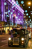 England, London, Soho, Oxford Street, Christmas decorations and London taxi