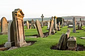 United Kingdom, Scotland, East Lothian, graves and celtic crosses in the Dunbar Parish Church's cemetery