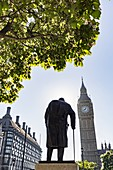 United Kingdom, London, Westminser district, Big Ben, the tower clock tower of the Palace of Westminster or Elizabeth Tower housing the famous Big Ben bell, in silhouette statue of Prime Minister Sir Winston Churchill
