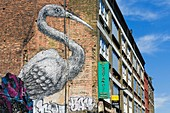 United Kingdom, London, Whitechapel / Brick Lane district, Brick Lane, the mural Crane painted by the Belgian artist Peter Roa