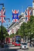 United Kingdom, London, Oxford Street between Marylebone and Mayfair districts, the Selfridges department store, double decker buses and London grey cab, United Kingdom flags