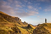 United Kingdom, Scotland, Highlands, Inner Hebrides, Isle of Sky, Trotternish Peninsula, woman looking the iconic landscape of Quiraing in Winter