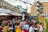 United Kingdom, London, East End, Spitalfields area, hipster quarter with terrace and lively courtyard on Sundays