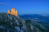 Medieval illuminated castle Rocca Calascio at the blue hour, Rocca Calascio, Gran Sasso National Park, Parco nazionale Gran Sasso, Apennines, Abruzzo, Italy
