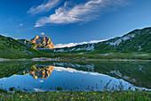 Gran Sasso reflected in mountain lake, Campo Imperatore, Gran Sasso, Gran Sasso National Park, Parco nazionale Gran Sasso, Apennines, Abruzzo, Italy