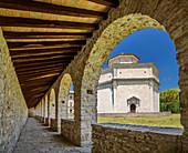 View from the arcade to Santuario Macereto, Grande Anello dei Sibillini, Sibillini Mountains, Monti Sibillini, National Park Monti Sibillini, Parco nazionale dei Monti Sibillini, Apennines, Marche, Umbria, Italy