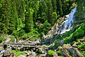Wooden bridge and viewing platform in front of Sintersbach waterfall, Sintersbach waterfall, Kitzbühel Alps, Tyrol, Austria
