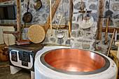 Copper kettle for cheese production and old stove, Großes Walsertal biosphere house, Großes Walsertal biosphere reserve, Bregenzerwald Mountains, Bregenzerwald, Vorarlberg, Austria