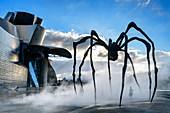 Guggenheim Museum, architect Frank O. Gehry, with artificial fog in front of sculpture Spider, artist Louise Bourgeois, Bilbao, Basque Country, Spain