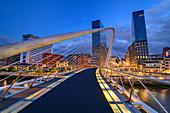 Illuminated Zubizuri footbridge over Nervion river, architect Santiago Calatrava, Bilbao, Basque Country, Spain