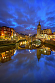 Illuminated old town of Bilbao with San Anton cathedral on Nervion river, Bilbao, Basque Country, Spain
