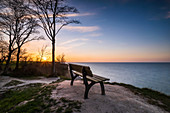 Bench with a view of the Baltic Sea in the evening, Weissenhäuser Strand, Ostholstein, Schleswig-Holstein, Germany