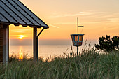 Sunrise on the beach of Dahme with DLRG watchtower, Baltic Sea, Ostholstein, Schleswig-Holstein, Germany