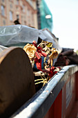 Dried up roses in a street container in Bratislava, Slovakia