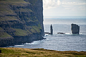 Rock needles in the sea in front of the Eiði, Eysturoy, Faroe Islands,
