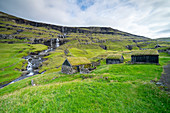 Historic grass-roofed houses in one of the most beautiful places in the world, Saksun, Streymoy Island in the Faroe Islands.