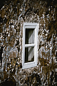 Window of a historic house in one of the most beautiful places in the world, Saksun, Streymoy Island in the Faroe Islands.