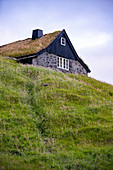 View of the historic house of Saksun, with a grassy roof, Streymoy Island in the Faroe Islands.