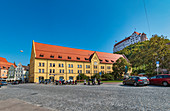 Postbank branch and Trausnitz Castle in the old town of Landshut, Bavaria, Germany