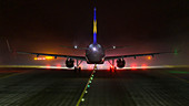 Airbus A320 at night and fog in front of the runway at Munich Airport, Bavaria, Germany