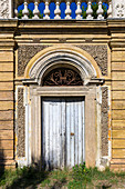 Old wooden door in the Casino Algardi, Rome, Italy
