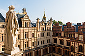 On the roofs of the Schwerin Castle surrounded by towers, domes, chimneys, Mecklenburg-Western Pomerania, Germany