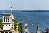 On the roofs of Schwerin Castle surrounded by towers, domes, chimneys - view to Schwerin Lake, Mecklenburg-Western Pomerania, Germany