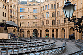 Chairs stand for an upcoming event in the courtyard of Schwerin Castle, Mecklenburg-Western Pomerania, Germany