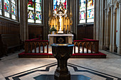 Baptismal bowl in front of the altar in the castle church in Schwerin. It is a Protestant church from the 15th century, Mecklenburg-Western Pomerania, Germany