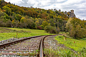 Railway track below the Neideck ruin in autumn, Streitberg, Upper Franconia, Bavaria, Germany