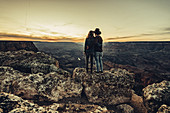 Couple looks out over Grand Canyon at sunset, Grand Canyon National Park, Arizona, USA, North America