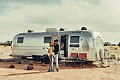 Couple hugging in front of Airstream in Flagstaff, Grand Canyon, Arizona, USA, North America