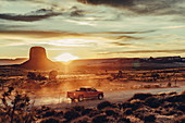 Pick-up truck at sunset in Monument Valley, Arizona, Utah, USA, North America