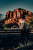 Woman stands at fence in Sedona, Arizona, USA, North America, America