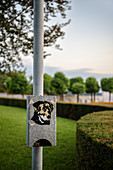 Station with dog poop bags in the castle gardens of Tettnang, Lake Constance, Baden-Wuerttemberg, Germany, Europe