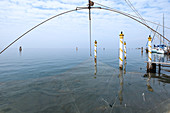 View of the Venice lagoon from the port of Pellestrina, in the foreground a fishing net, Pellestrina, Veneto, Italy, Europe
