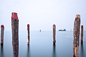 View of the fishing huts on stilts of the fishermen of Pellestrina in the Venetian lagoon, Pellestrina, Veneto, Italy, Europe